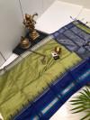 Raw silk saree with silver zari checks and contrast pallu