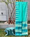 Sea green color pure silk saree with ikat weaving design