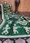 Green color raw silk saree with zari woven contrast pallu
