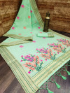Pista green color linen saree with zari weaving border