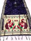 Navy blue color paithani silk saree with attractive zari weaving pallu