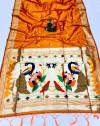 Orange color paithani silk saree with attractive zari weaving pallu