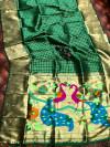 Green color paithani silk saree with attractive pallu