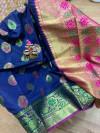 Navy blue colored Soft banarasi silk saree with woven design