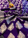 Purple colored Banarasi silk saree with jacquard weaving work