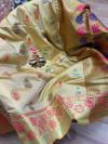 Off white colored Soft banarasi silk saree with woven design