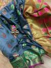 Grey colored Soft banarasi silk saree with woven design