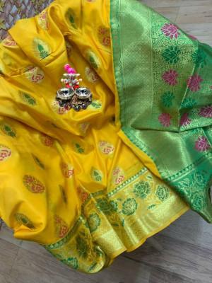 Yellow colored Soft banarasi silk saree with woven design